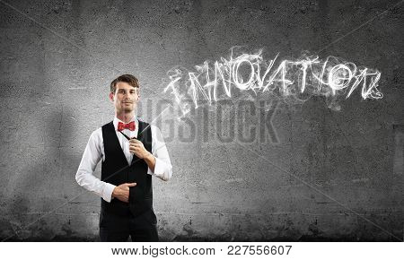 Horizontal Shot Of Confident And Young Businessman In Smart-casual Wear Smoking Pipe While Standing