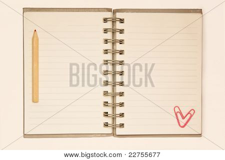 Blank Notepad With Pencil And Paperclip