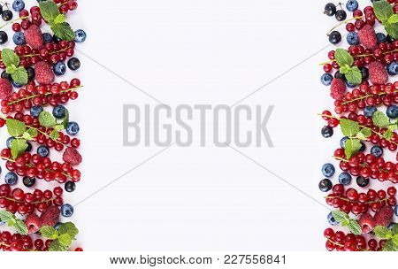 Black-blue And Red Fruits. Ripe Currants, Raspberries, Blackberries And Blueberries On White Backgro