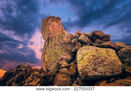 The Dobrogean Sphinx. Rocks Formations In Dobrogea, Tulcea Country, Romania. Naturally Formed Piles