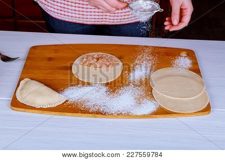 Traditional Crimean Tatar Dish- Cheburek On Wooden Background Is Ready To Fry