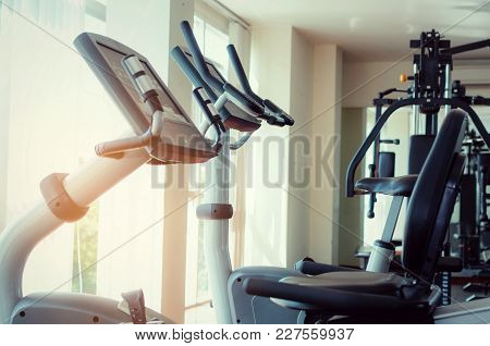 Bicycle Machine Or Treadmill Machine, Exercise Machine And Gym Equipment In Empty Fitness Gym Center