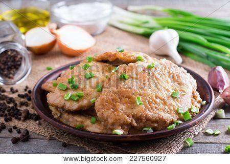 Pork Chops In A Plate. Pork Schnitzel In A Plate