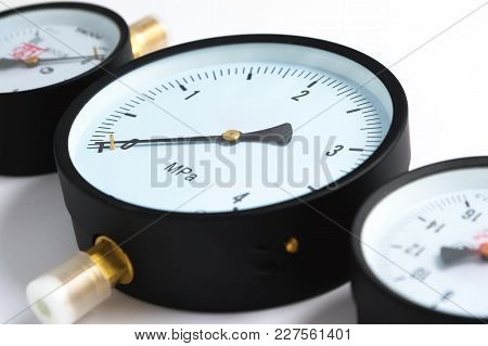 Close-up Pressure Sensors In The Pipeline - Mono-meters. Three Monometers Of Different Sizes On A Wh