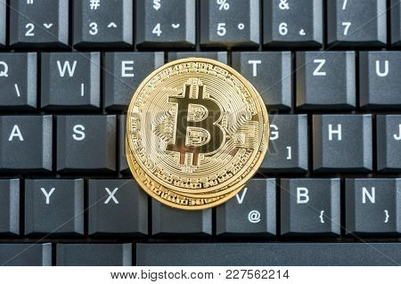 Conceptual Of Cryptocurrency With Golden Bitcoins On A Black Keyboard, Top View.