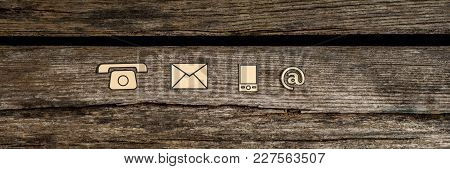 Wide Panorama  Top View Of  Contact Icons Phone, Web, Mobile And Mail On Rustic Wood.