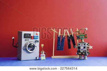 Robot Automation Laundry Room. Silver Washing Machine, Men's Jeans Pants Dried On Clothesline With C