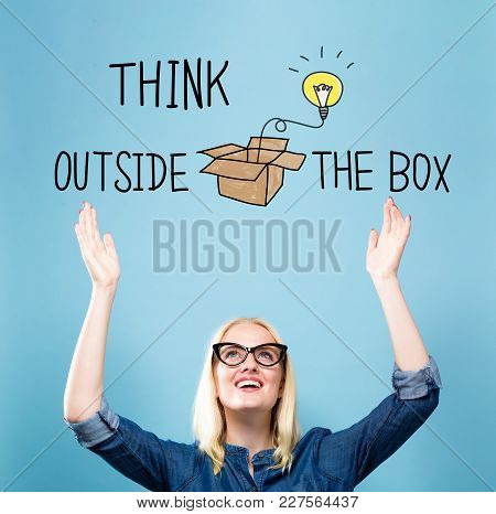 Think Outside The Box With Young Woman Reaching And Looking Upwards