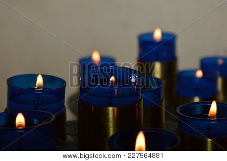 Zoom On Blue Candels In A Small Chuch