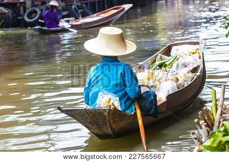 Damnoen Saduak, Thailand :- June 30, 2017 :- Floating Market - Many Small Boats Laden With Colorful