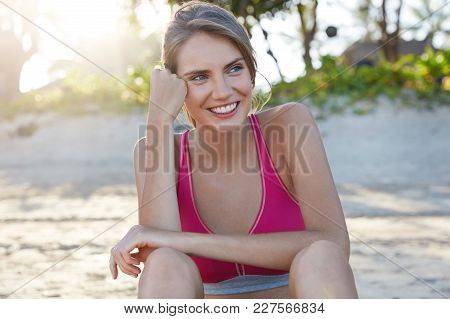 Motivated Sporty Woman Has Break After Training, Satisfied With Hard Workout, Enjoys Beautiful Natur