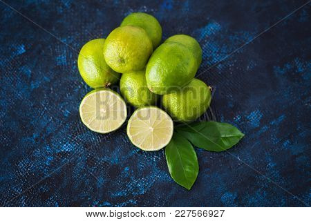 fresh lime on dark background - fruits and vegetables