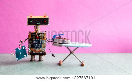 Robot Hanger Blouse, Iron On The Board. Pink Wall Green Floor Room Interior. Creative Design Toys Ho