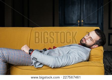 Depressed Elegant Man Resting And Lying On Couch