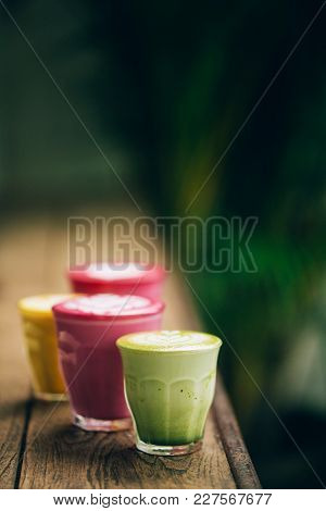 Two Trendy Beetroot Lattes With Latte Art And Flower Petals On Foam.an Authentic Girl Dances On The