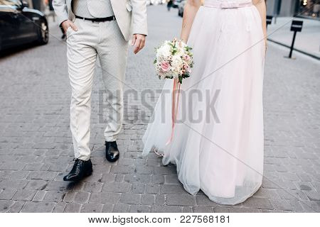 The Bride And The Groom Are Walking By, Faces Are Not Visible