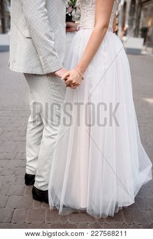 The Bride And The Groom Are Standing By, Faces Are Not Visible