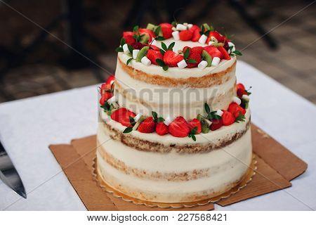 Wedding Cake With Fresh Strawberries And Kiwi