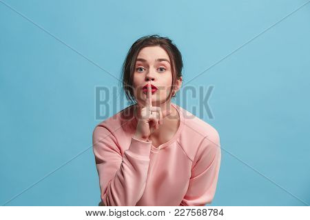 Secret, Gossip Concept. Young Woman Whispering A Secret Behind Her Hand. Business Woman Isolated On