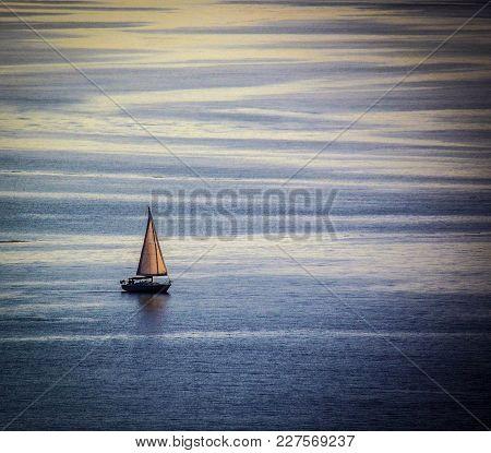 Sailboat Sailing On A Calm, Flat Sea