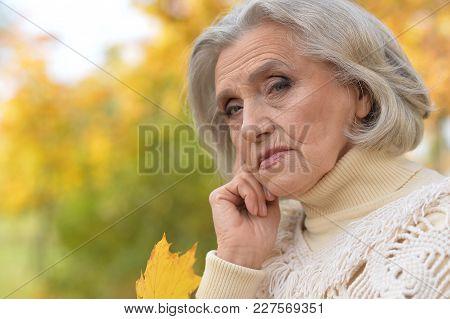 Portrait Of A Sad Senior Woman Outdoors