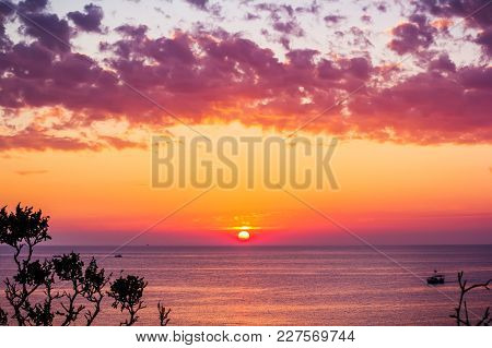 Beautiful Pink Sunset And Ocean, Red Clouds And Boats