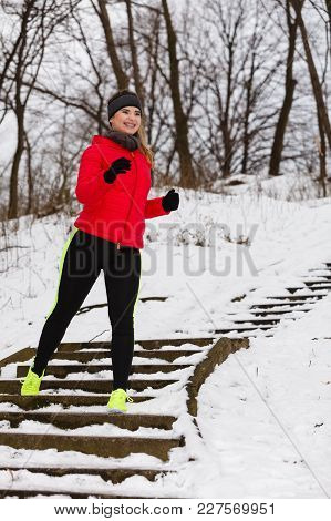 Woman Wearing Sportswear Exercising During Winter