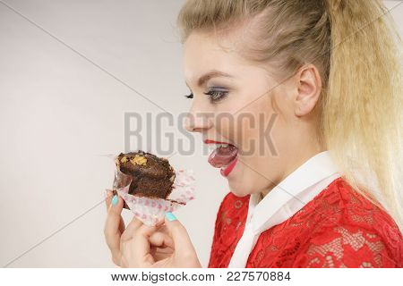 Sweet Food Sugar Make Us Happy. Attractive Blonde Woman Holds Yummy Chocolate Cupcake In Hand, Open