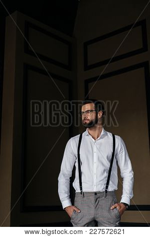 Handsome Elegant Man Posing In White Shirt And Suspenders