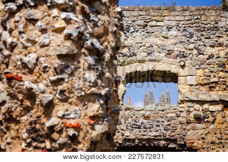 Canterbury Cathedral  seen through window of ruined St Augustine's Abbey wall, the oldest Benedictine monastery in Canterbury, Kent Southern England, UK. UNESCO World Heritage Site