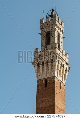 View On The Upper Part Of The Torre Del Mangia On The Piazza Del Campo In Siena, Italy