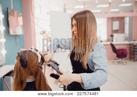 Close-up Of Master Hairstylist Combing His Hair. Healthy Hair