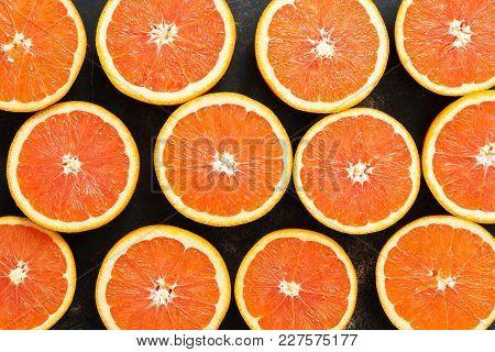 Background Of Halves Of Orange. Juicy Orange Is Cut In Half