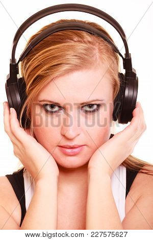 Portrait, Musicaly, Passion Concept. Studio Shot Blonde Young Woman Listening To Music On Big Headph