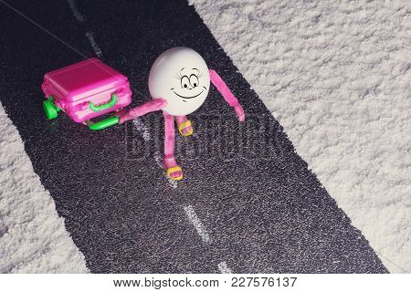 Funny Egg Girl Walking By The Road In A Desert. Travel Concept.