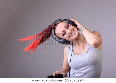 Sporty Young Woman Dancing To Music