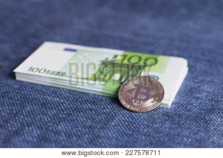 Bitcoin And Euro Currency On Blue Background
