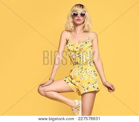 Fashionable Female Blond Model, Trendy Sunglasses. Stylish Glamour Summer Yellow Outfit. Young Beaut