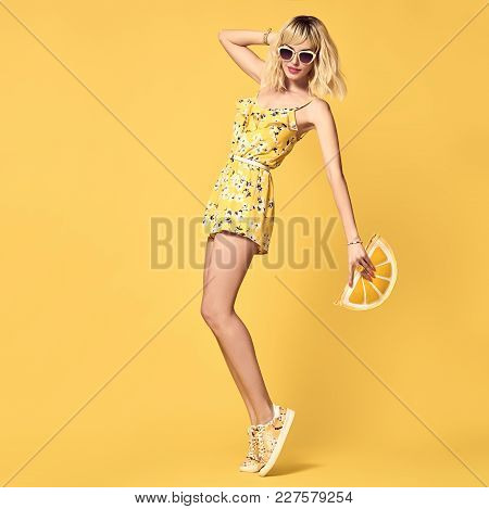 Young Fashionable Female Blond Model Dancing. Glamour Short-haired Girl In Trendy Yellow Playsuit, S