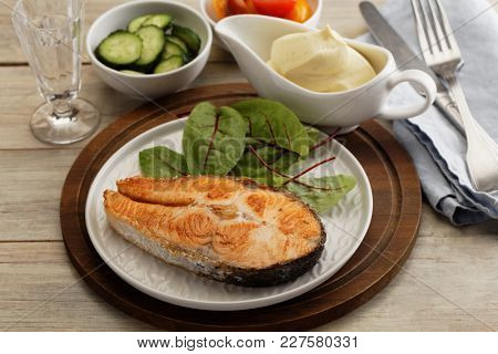 Roasted salmon steak with vegetables