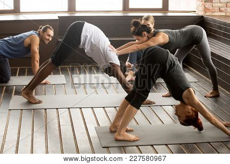 Yoga Fitness Instructor Teacher Helping African Man Beginner Doing Stretching Downward Facing Dog Ex