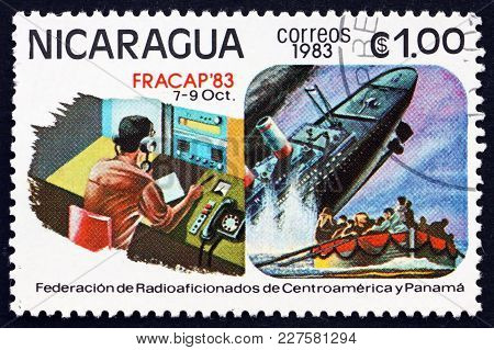 Nicaragua - Circa 1983: A Stamp Printed In Nicaragua Shows Ship-to-shore Communications, Sinking Shi