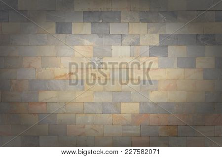 The Wall Is Made Of Marble Gray And Orange Tiles. Beautiful Stone Texture. Empty Unusual Background