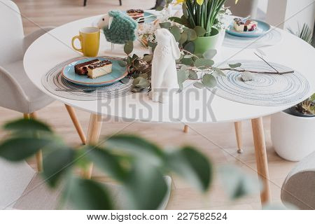 Pastel Table Setting With Yellow Cups, Daffodils And Eggs, Close Up
