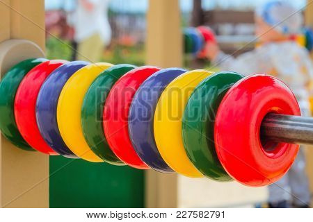 Children's Outdoor Gaming Complex With Colored Rings Bills For Small Kids. Selective Focus And Limit
