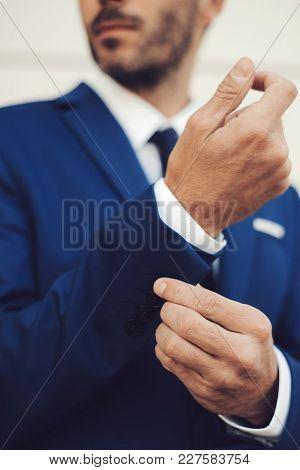 Close-up Portrait Of Elegant Male Model Wearing A Suit.