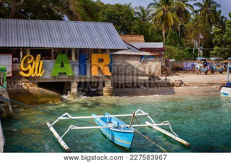 Port Of The Island Of Gili Air. Indonesia The Indian Ocean. The Arrival Of The Boats With Tourists.