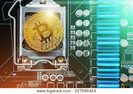 Cryptocurrency Golden Bitcoin Coin On Printed Circuitboard. Conceptual Image For Crypto Currency, To