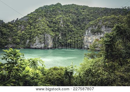 Tropical Lagoon Bay Landscape With Limestone Rocks And Palm Trees With Lush Foliage And Turquoise Se
