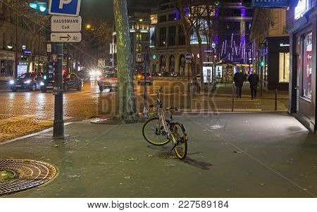 Paris, France - December 11, 2017: Bicycle From The Bike Sharing System Stands On The Sidewalk. Even